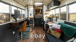 RV school bus conversion Off grid Skoolie with solar power and roof raise